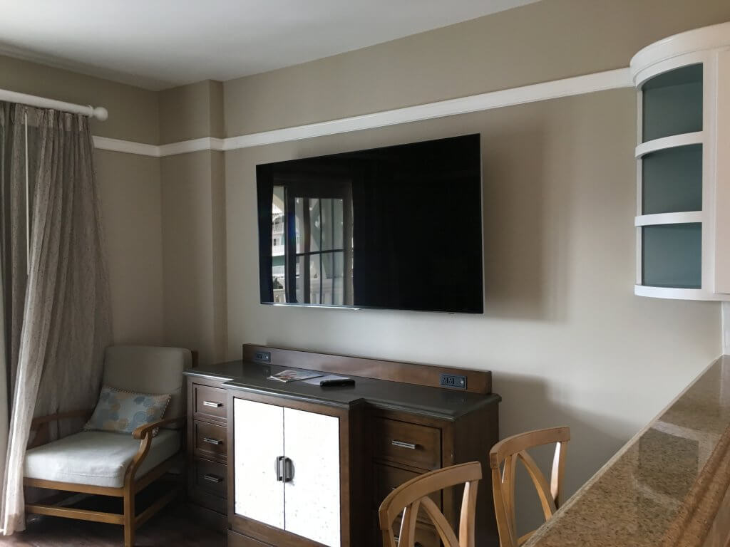 DVC BCV: So much to love about our one bedroom villa at Disney's Beach Club Resort living area dresser with television